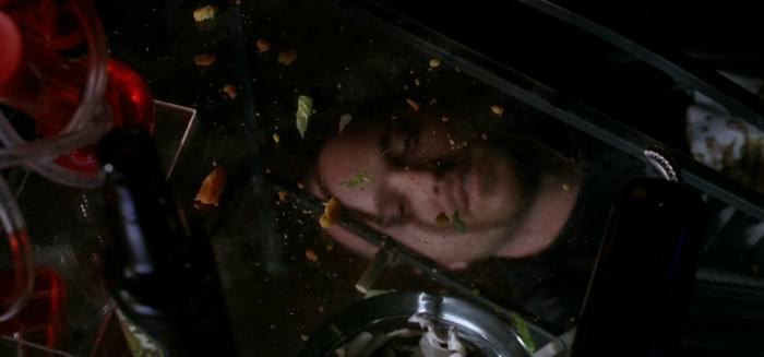 "Aaron Paul under a coffee table in Breaking Bad Season 5 Episode 9 - ""Blood Money"""