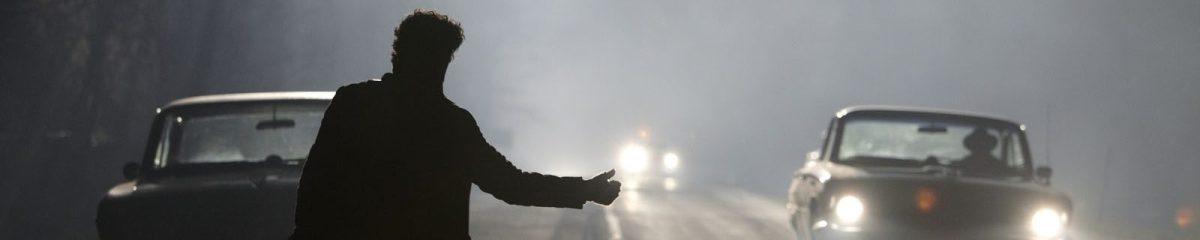 Oscar Isaac in silhouette in Inside Llewyn Davis (2013)